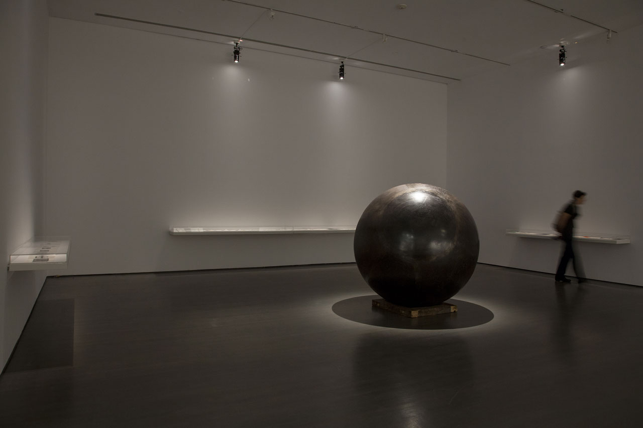Hajra Waheed, Installation view of 'KH-21', 2014, La Biennale de Montreal (BNLMTL) at the Musee d'art contemporain de Montréal, Sound Sculpture Steel, Brass, Leather & Wood 64 in. sphere diameter / 25ft. cord / 10 min. loop. Image courtesy the artist.