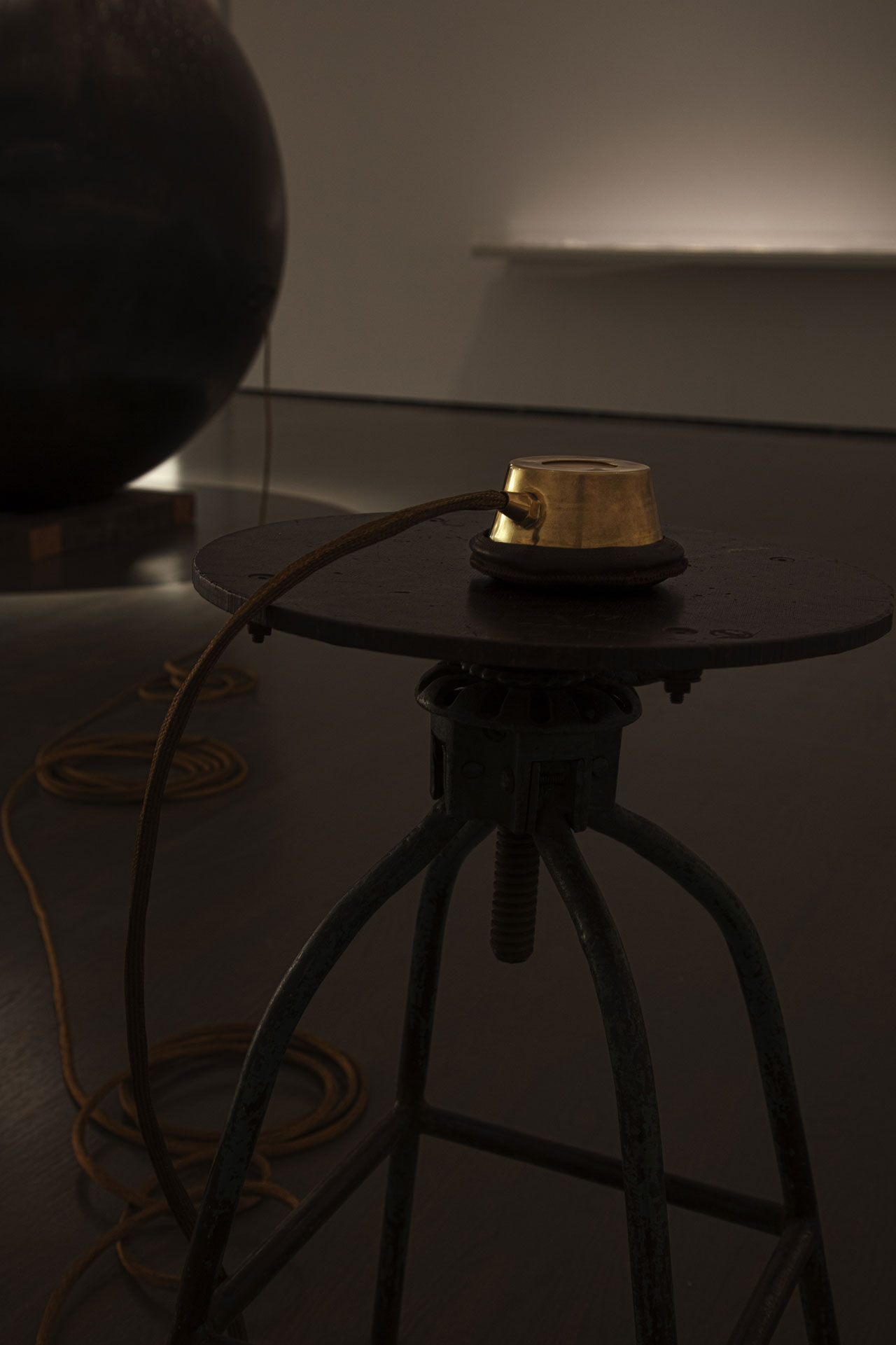 Hajra Waheed, Installation detail of 'KH-21', 2014, La Biennale de Montréal (BNLMTL) at the Musée d'art contemporain de Montréal, Sound Sculpture Steel, Brass, Leather & Wood 64 in. sphere diameter / 25ft. cord / 10 min. loop. Image courtesy the artist.