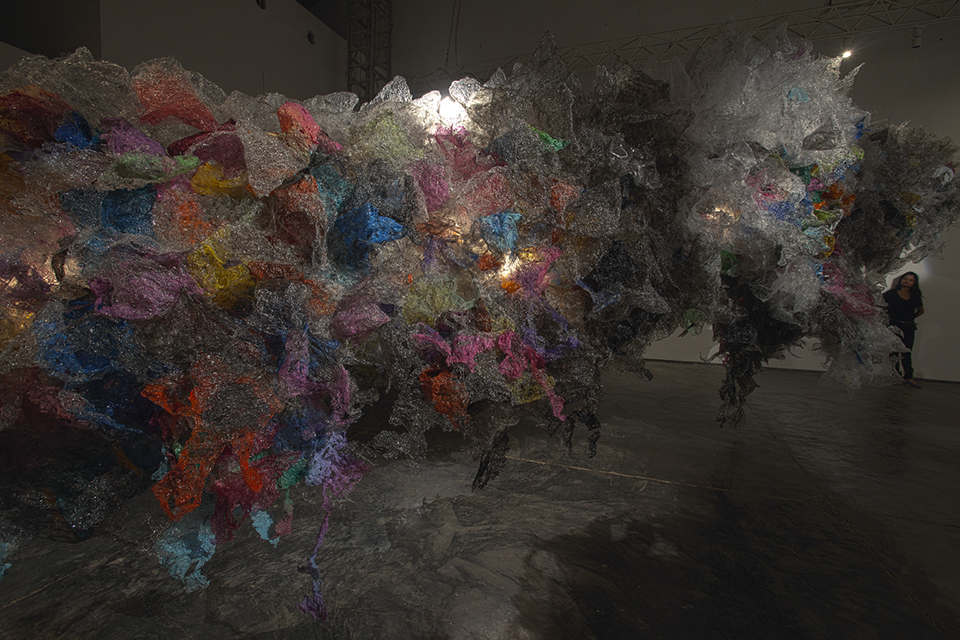 "Aaditi Joshi, 'Untitled', 2011, fused plastic bags, acrylic paint, on wooden and acrylic base, 110 x 94 x 432 in. Installation view of ""New Works' 2011-12"" at Gallery Maskara. Image courtesy the artist and Gallery Maskara."