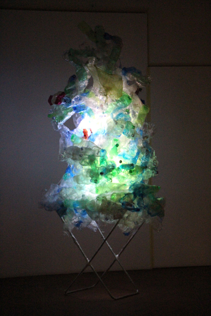 "Aaditi Joshi, 'Untitled', 2013, used plastic PET bottles, found aluminum stand, LED light, 96 x 65 in (approx.). Site-specific installation from the show ""People Without Memory is a People Without Future"" at Casa Masaccio, Italy. Image courtesy the artist."