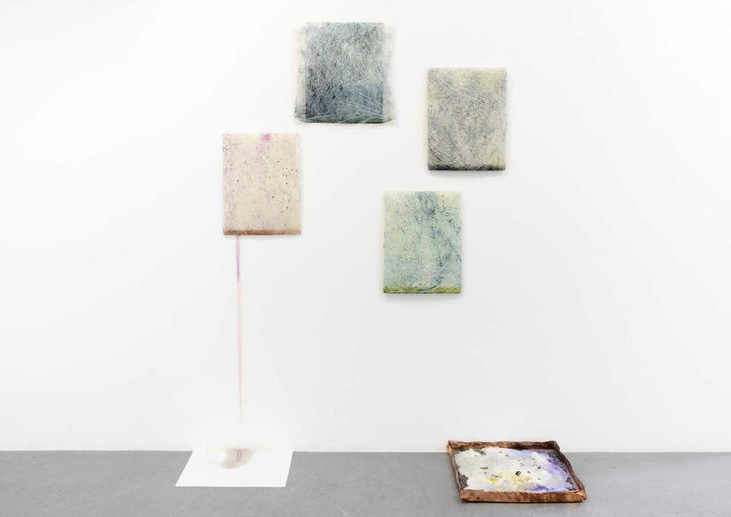 "David Prytz, ""Literal"", installation view. Wall: 'Dumb Alchemy', 2014, paper, pigments, plastic foil, 40 x 40 cm and 30 x 40 cm. Ground: 'Dumb Alchemy', 2014, copper, pigments, soil, zinc, acrylic, brass, aluminium, marble, hot glue, plaster, stones, 43 x 43 cm. Photo: Roberto Apa. Image courtesy Galleria Mario Iannelli."